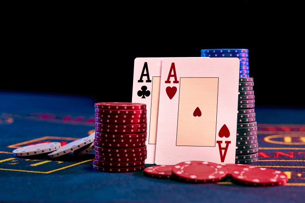 Stack of Chips and a Pair of Aces