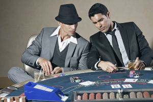 Two guys playing blackjack